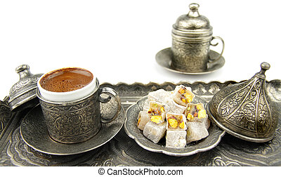 Turkish coffee and turkish delight with traditional metal...