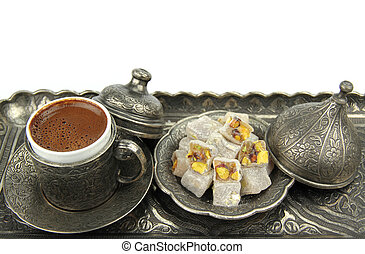 Turkish coffee and turkish delight with traditional embossed...