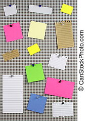 Various note papers on cork board