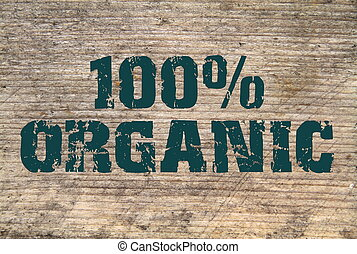 100 Organic stamped text on old plank close up image