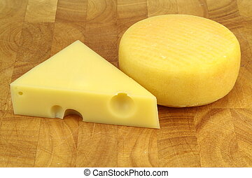 Emmental and kashar cheese on wood background