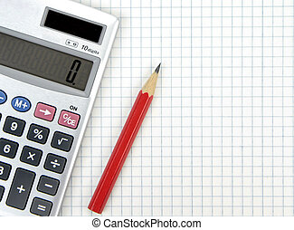 Calculator and lead pencil on squared paper close up image