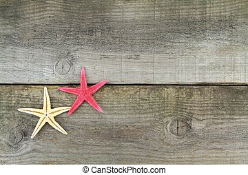 Starfishes on old plank,close up image