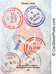 Visa stamps in Turkish passport close up image