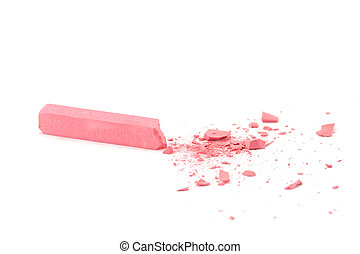 Crumbled pink chalk on white background