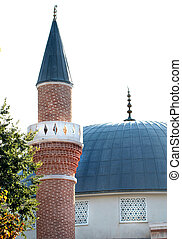 Mosque domes, minaret, and alems close up image