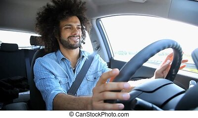Handsome man driving car - Happy man having fun driving car...