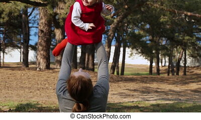 Toss old child in nature - Year-old child and mother throws...