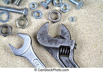 Wrench, monkey wrench and various bolts and nuts