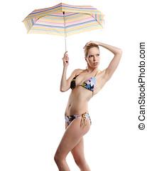 woman in bikini with umbrella