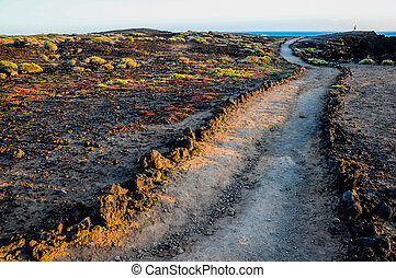 Pathway in the Volcanic Desert - Travel Concept Background -...