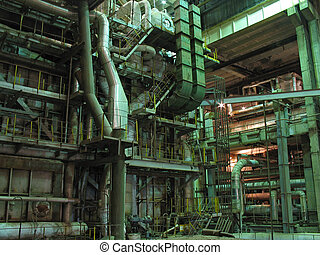 machinery, pipes, tubes, steam turbine at a power plant, night scene