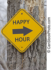 Happy Hour Sign on a Tree - A yellow and black diamond...