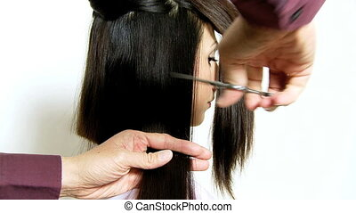 Cutting long piece of hair - Hair stylist cutting long hair