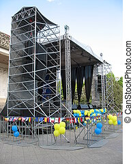 scene open air concerto metallic stage with blue and yellow...