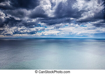 Overcast weather over sea, dark dramatic cloudy sky,...