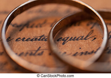 Marriage Equality - Wedding rings on the US Constitution...