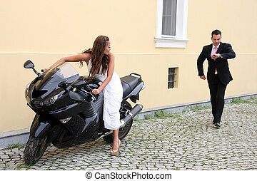 Young wedding couple with motorbike - Wedding on the nature,...