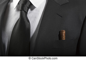 Jacket and tie with cuban cigar in the pocket, Italian...