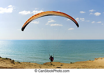 Paraglider flying above Mediterranean near Arsuf coast about...