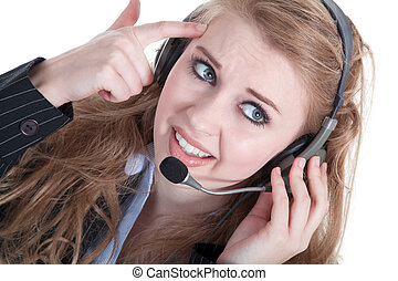 Business woman with headset is angry on the phone