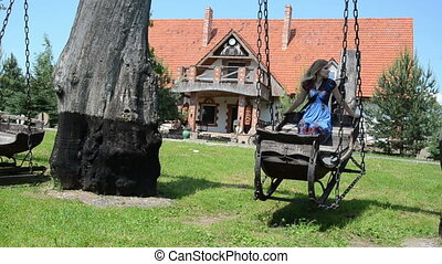 sledge swing iron chains - girl swinging a sledge swings...