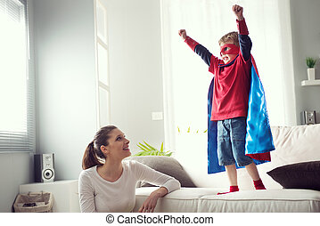 Little superhero with his mother - Mother looking at little...
