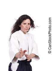 Aikido teacher posing isolated over white background