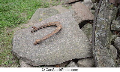 pile horseshoe - hand put into a pile of rusty iron...