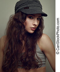 Trendy hiphop young woman in grey cap. Closeup vintage...