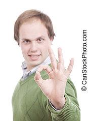 casual man signaling Ok - Young casual man signaling Ok -...