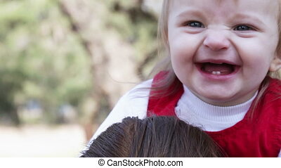 Babys head laughing - One year old baby smiling while...