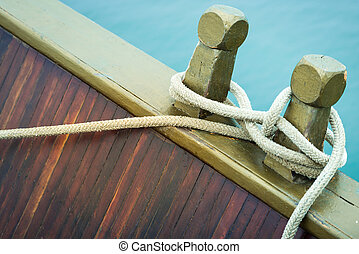 Close-up of rope with tied sea knot on ship deck - Marine...