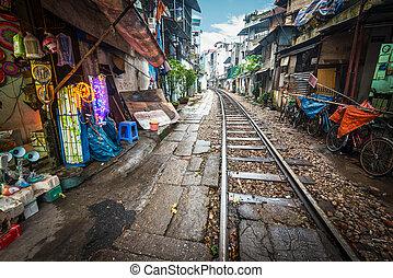 Railway crossing the street in city, Vietnam. - Perspective...