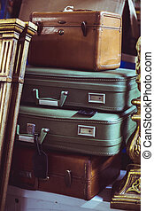 stack of vintage suitcases - stack of brown and green...