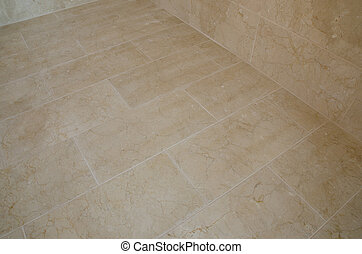 Marble tiled floor - A newly tiled bathroom floor with...