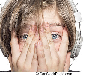 desperate male teenager with headphones covering his face...