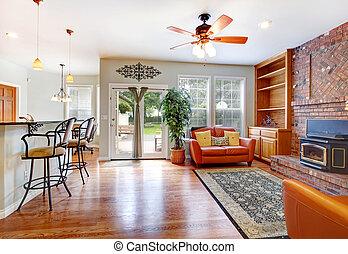Luxury living room with doors to backyard