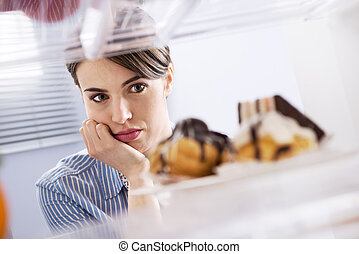 Craving sweet food - Young hungry woman in front of...