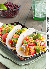 Migas Tacos - Tacos filled with migas, a Tex-Mex dish of...