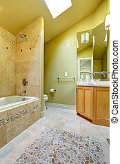 Bathroom with tile and stone trim - Vaulted ceiling bathroom...