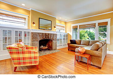 House interior.Yellow living room with fireplace