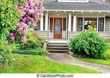 House exterior. Entrance column porch - House exterior. View...