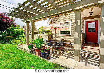 Backyard patio area - Backyard porch with red door and...