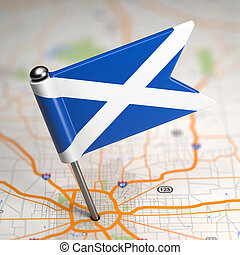 Scotland Small Flag on a Map Background. - Small Flag of...