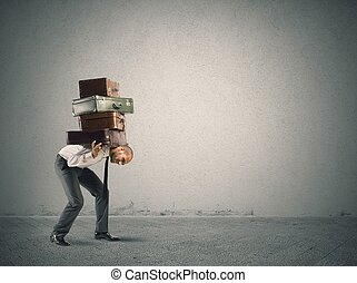 Difficulty - Businessman carrying heavy suitcases. concept...