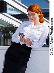 happy businesswoman with phone