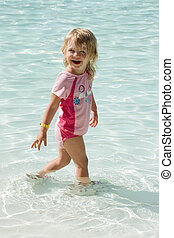 Toddler Girl Swimming - Cute toddler girl swimming in a...