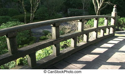 Stone Garden Bridge - Standing on a stone bridge in the...
