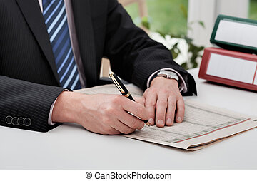 Stocks and shares - A man checking the stock and shares in a...
